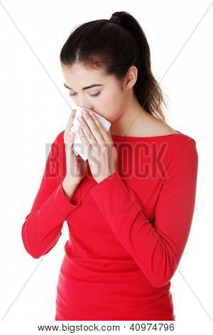 Teen woman with allergy or cold , isolated on white