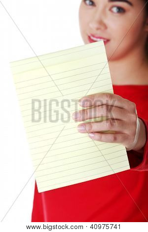 Young happy student woman showing blank notepad, isolated on white background