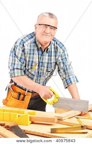 Male carpenter working in a workshop isolated on white background