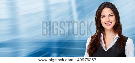 Portrait of happy young business woman on blue background.
