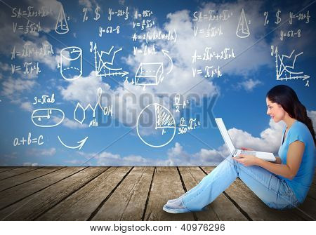 Young student woman with laptop computer. Technology.