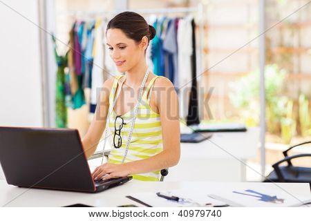 modern fashion designer sketching using laptop computer