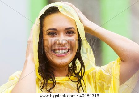 happy young woman in raincoat outdoors