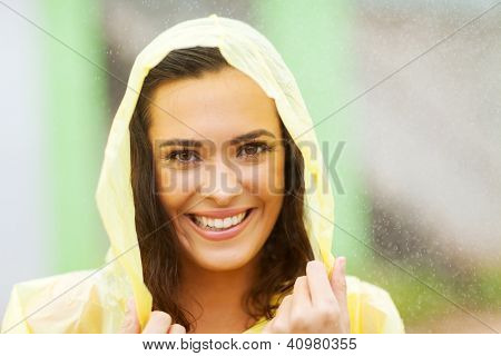 beautiful woman dress in raincoat in the rain