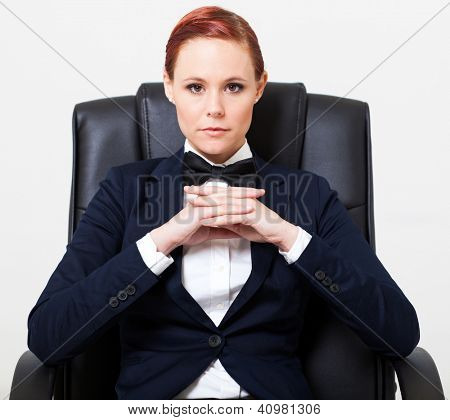 cool fashion woman in suit sitting on office chair