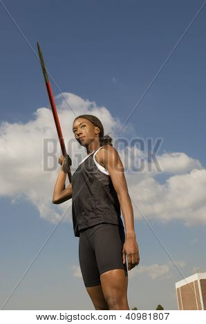 Female athlete throwing javelin