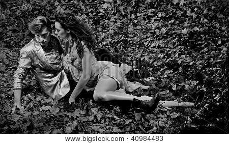 Couple lying on autumn leaves