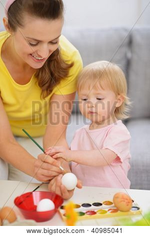Happy Mother And Baby Painting On Easter Eggs