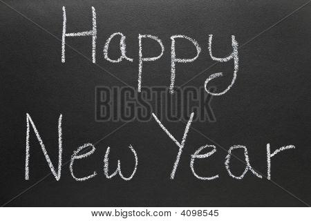 Happy New Year Written On A School Blackboard.