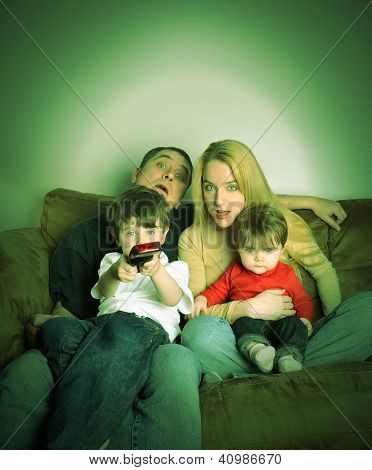 Family Watching Movie Tv At Home