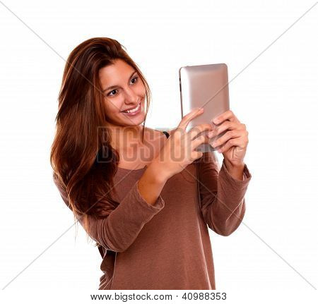 Smiling Young Woman Reading On Tablet Pc Screen