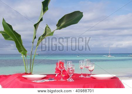 table set for meal on tropical beach