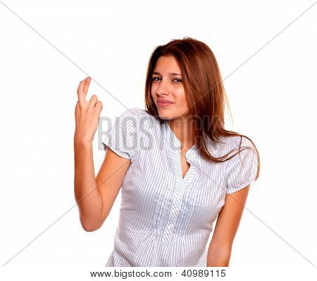 Young Woman Making A Wish Crossing The Fingers
