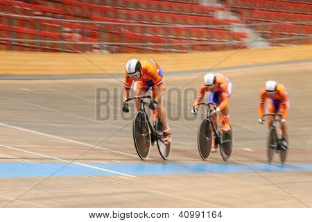 VIENNA,  AUSTRIA - SEPTEMBER 27  Hugo Haag,  Nils Hoenderdaal, and Jeffrey Hoogland (Netherlands) compete in the men's team sprint event of an cycling meeting on September 27, 2012 in Vienna, Austria.