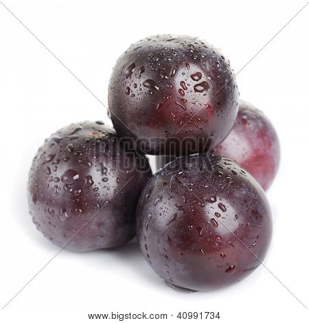 Plum fruit with dew isolated on white background