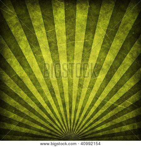 Green grunge sunbeams background or texture