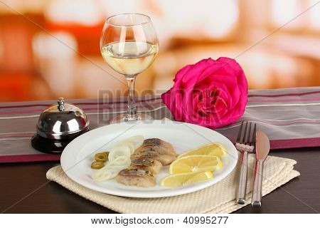 Dish of herring on plate on table on restaurant background close-up