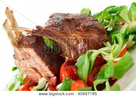 Rare fried rack of lamb isolated on white background, close-up shot