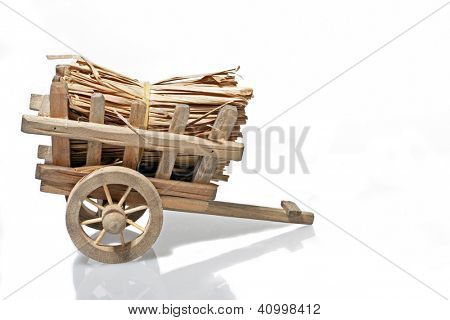 Old handcart with straw on a white background