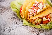 foto of tacos  - Chicken tacos with lettuce tomato and sauce - JPG