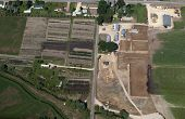 stock photo of feedlot  - aerial view of a tree farm and a cattle feedlot - JPG