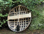 stock photo of coracle  - A Traditionally Made One Man Coracle Basket Boat - JPG