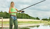 image of fisherwomen  - woman fishing at pond - JPG