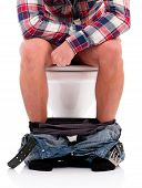 stock photo of diarrhea  - Man is sitting on the toilet bowl - JPG