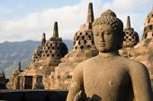 stock photo of buddha  - Buddha statue and stupas in Borobudur or Barabudur temple Jogjakarta Java Indonesia - JPG