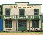stock photo of gunfights  - Saloon and hotel in Wild West style - JPG
