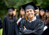 picture of graduation  - graduation man in front of a group of graduation students - JPG