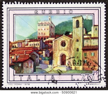ITALY �¢?? CIRCA 1978 a stamp printed in Italy shows an illustration of Gubbio, medieval town in the Umbria region, central Italy. Italy, circa 1978