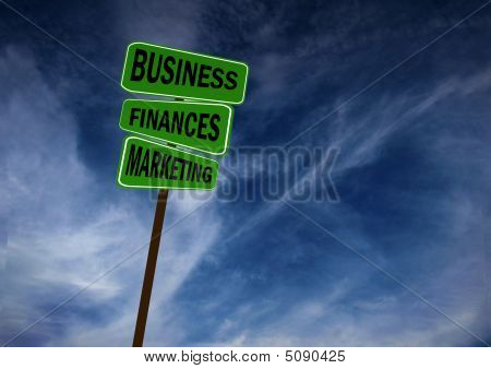 Business Signs Against Blue Sky
