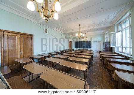 MOSCOW - MAY 13: Classroom with tables and chandeliers in the Faculty of Physics in Moscow State University on May 13,2013 in Moscow, Russia.