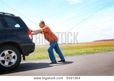 Man Pushing The Car
