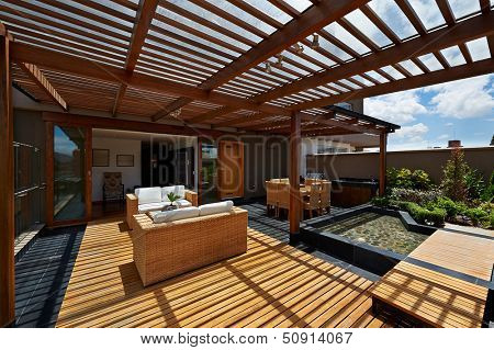 Interior design: Beautiful terrace lounge with pergola