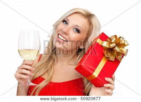 Portrait Of A Beautiful Blonde Girl In A Red Dress With A Glass And A Gift