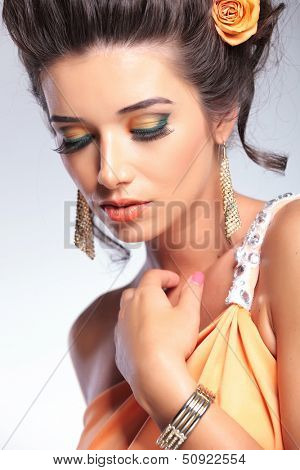 closeup of a young fashion woman looking down. on gray background