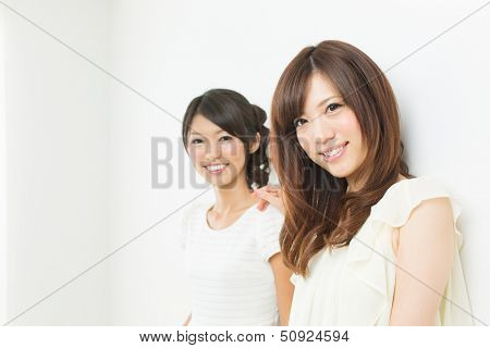 Beautiful young women relaxing in the room