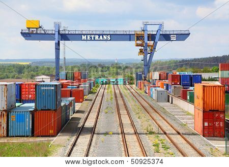 NYRANY, CZECH REPUBLIC - MAY 25: Big container terminal on a railroad with open storage area 50 000sqm. Terminal has a capacity of 40 trucks/day. May 25, 2013 in Nyrany, Czech Republic.