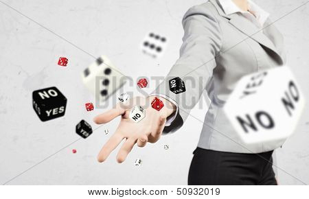 Close-up image of businesswoman throwing dices. Gambling concept