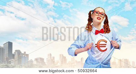 Young woman acting like super hero with euro sign on chest