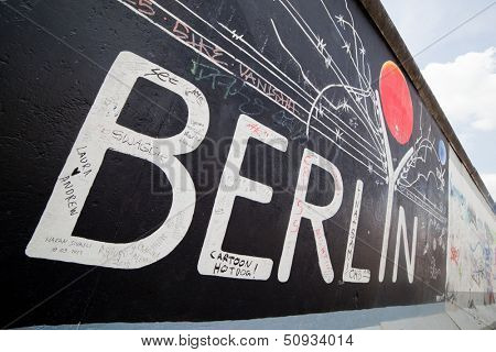 BERLIN, July 26: Graffiti at the East Side Gallery on July 26, 2013 in Berlin,Germany. It documents a time of change and hopes for a better future. Removing some sections now stirs up controversy