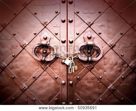 Old wooden door with metal handle and circuit