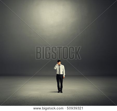 sad businessman in dark room