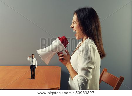 mad woman screaming at man with gun