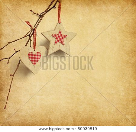 Christmas decoration hanging over old paper background.