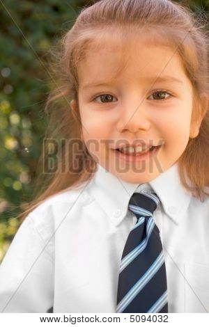 Young Boy With Long Hair In White Shirt And Tie