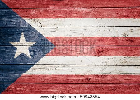 puerto rican flag on wood texture background