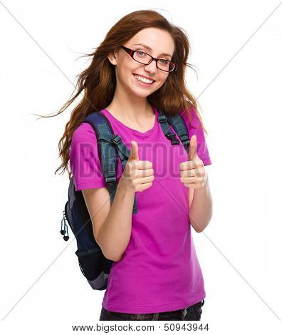 Young student girl is showing thumb up sign using both hands, isolated over white